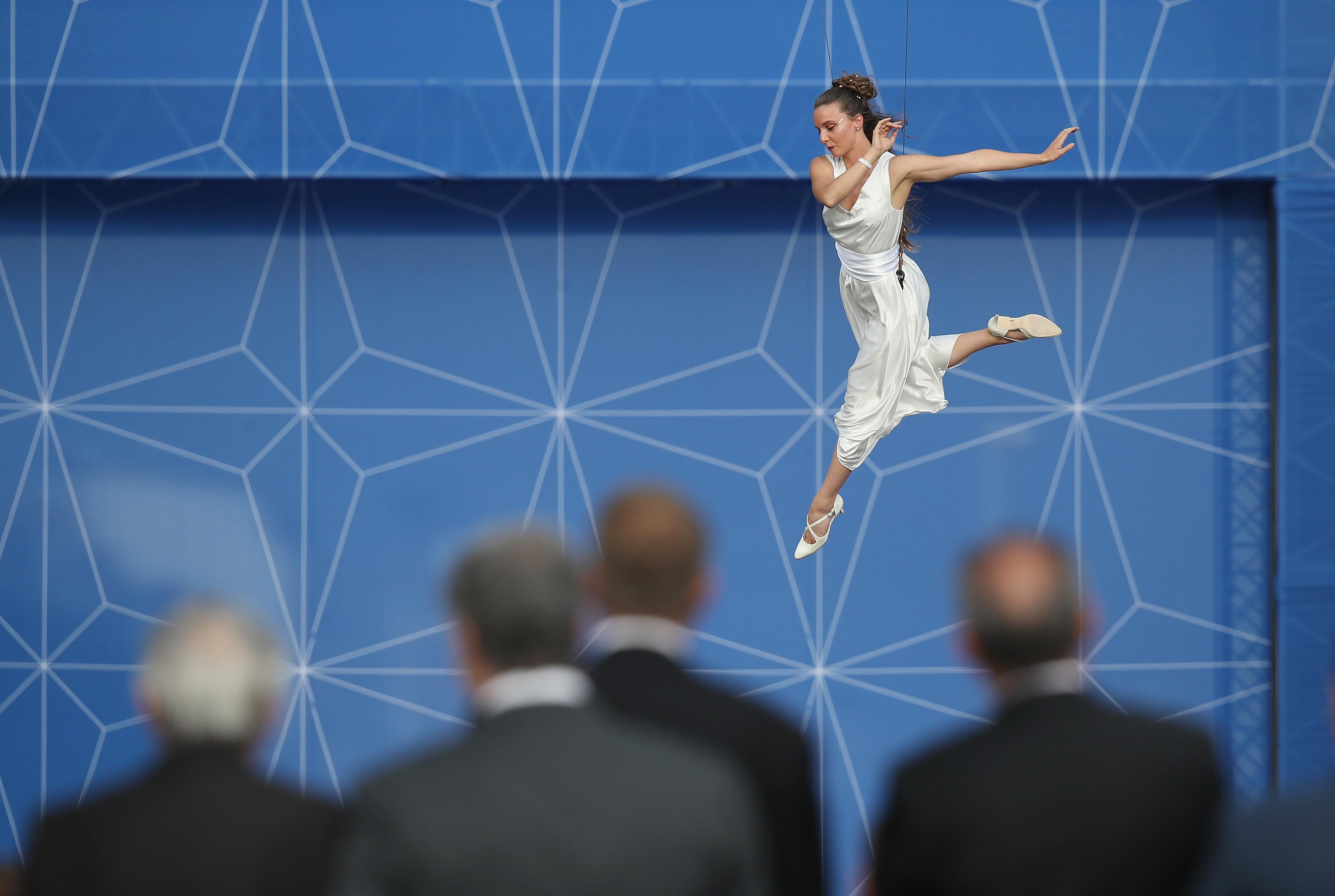 BRUSSELS, BELGIUM - JULY 11:  A performer dances suspended from balloons as heads of state and governments, as well as their spouses, watch at the evening reception and dinner at the 2018 NATO Summit on July 11, 2018 in Brussels, Belgium. Leaders from NATO member and partner states are meeting for a two-day summit, which is being overshadowed by strong demands by U.S. President Trump for most NATO member countries to spend more on defense.  (Photo by Sean Gallup/Getty Images)
