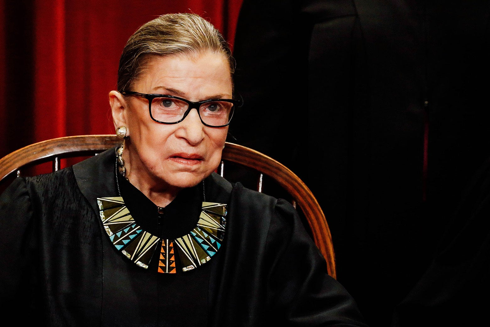 Justice Ruth Bader Ginsburg poses for a photo of the Supreme Court justices.