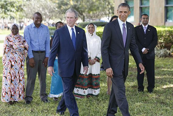 U.S. President Barack Obama (front, R) and former President George W. Bush (front, L) attend a memorial for the victims of the 1998 U.S. Embassy bombing in Dar es Salaam July 2, 2013.\
