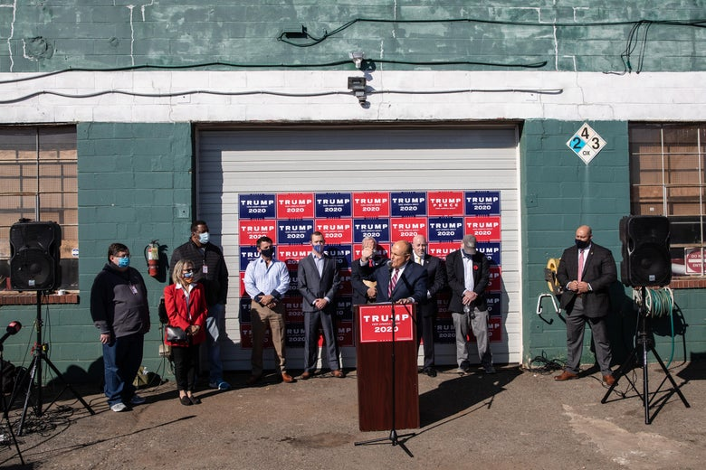 Attorney for the President, Rudy Giuliani speaks to the media at a press conference held in the back parking lot of Four Seasons Total Landscaping on November 7, 2020 in Philadelphia, Pennsylvania.