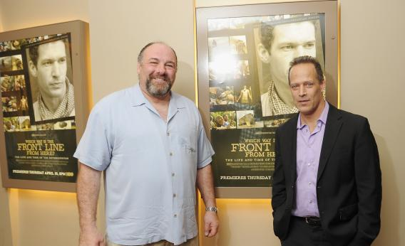 James Gandolfini and filmmaker/journalist Sebastian Junger attend the New York premiere of Which Way Is the Front Line From Here? at the HBO Theater on April 10, 2013, in New York City.