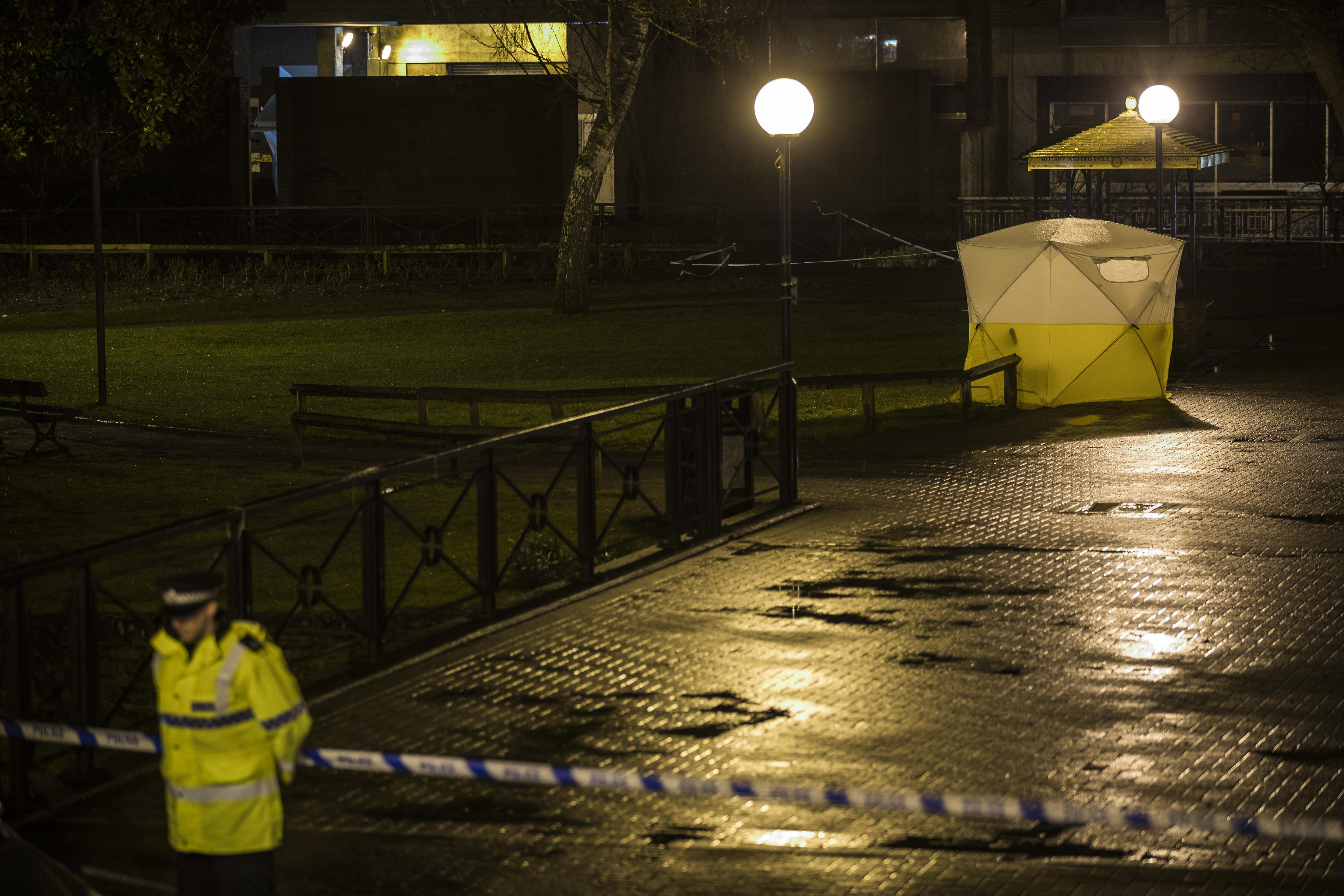 A forensic tent around a bench where Sergei Skripal was found unconscious in Salisbury, England.