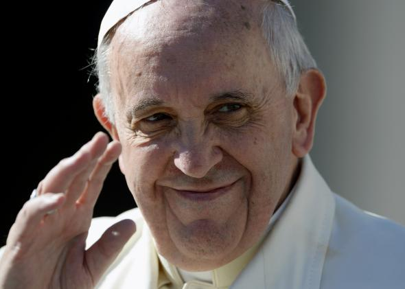 Pope Francis waves at the end of his weekly general audience on March 5, 2014.