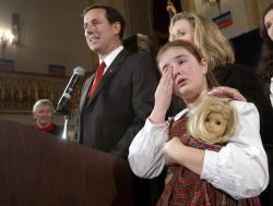 U.S. Senator Rick Santorum stands next to his wife Karen and his daughter Sarah Maria.
