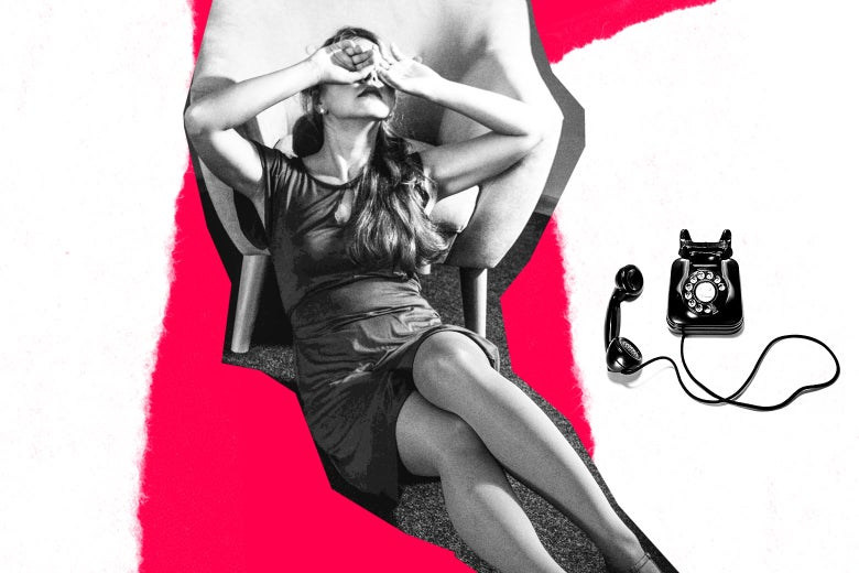 Woman covering her eyes as she sits next to a telephone.