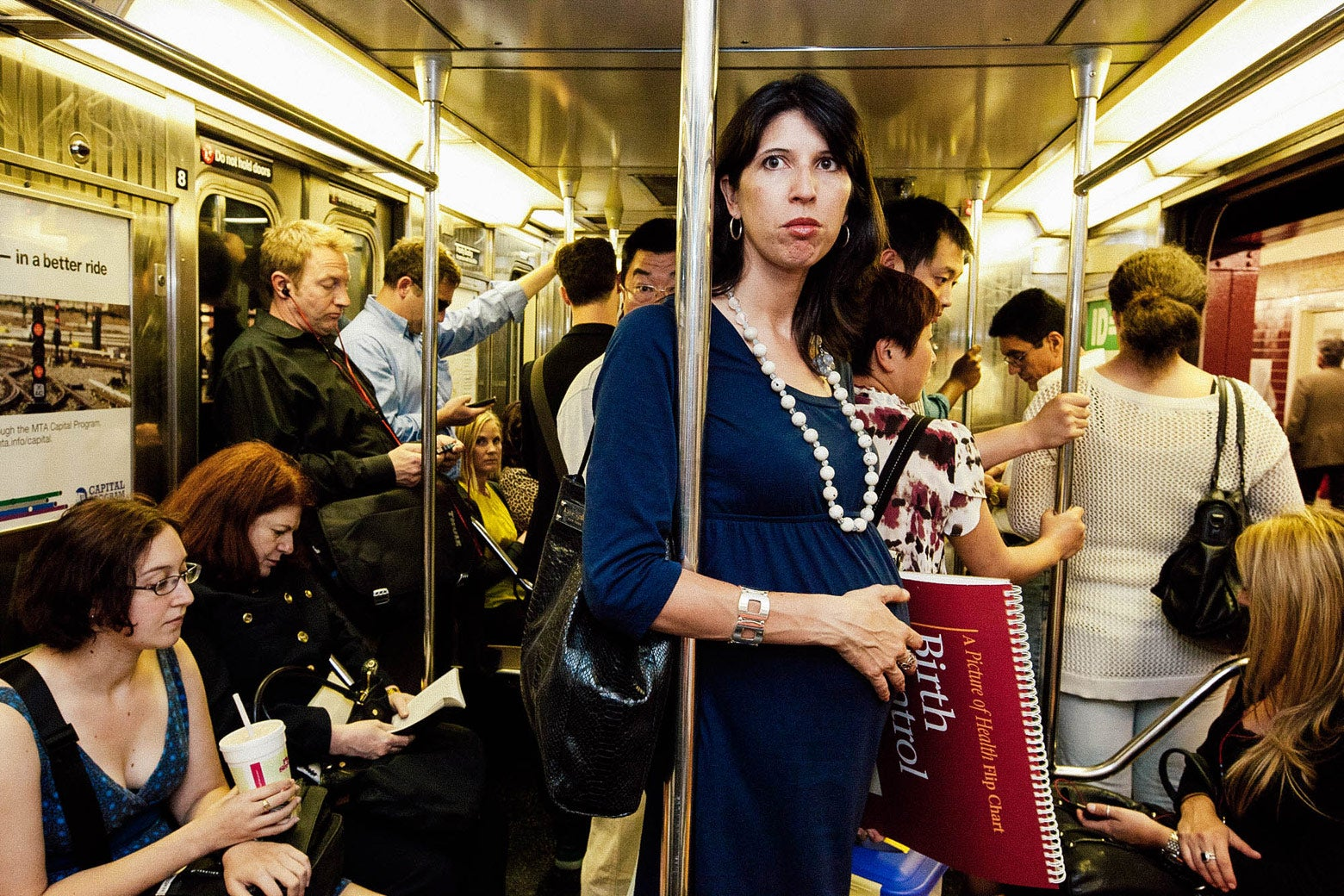 Amanda rides the subway.