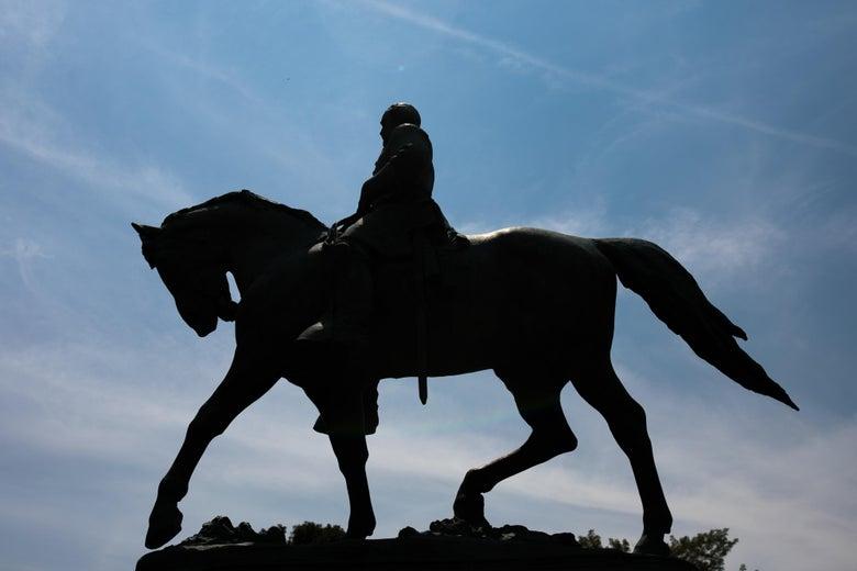 A statue of Confederate General Robert E. Lee on horseback.