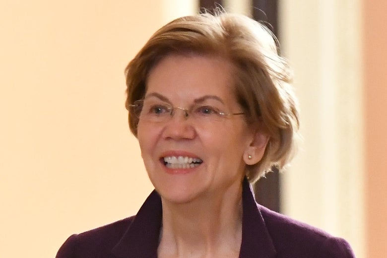 Elizabeth Warren walks through the Senate halls