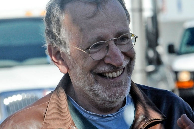 A smiling late-middle-aged white man in casual clothes.