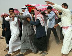 Syrians carry the coffin of a realtive killed in a U.S. attack. Click image to expand.