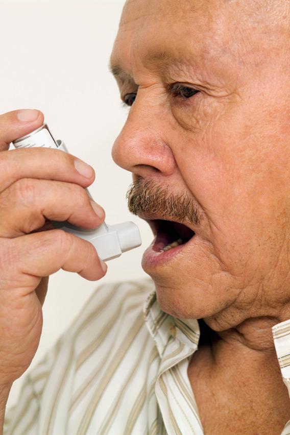 Man using an asthma inhaler.