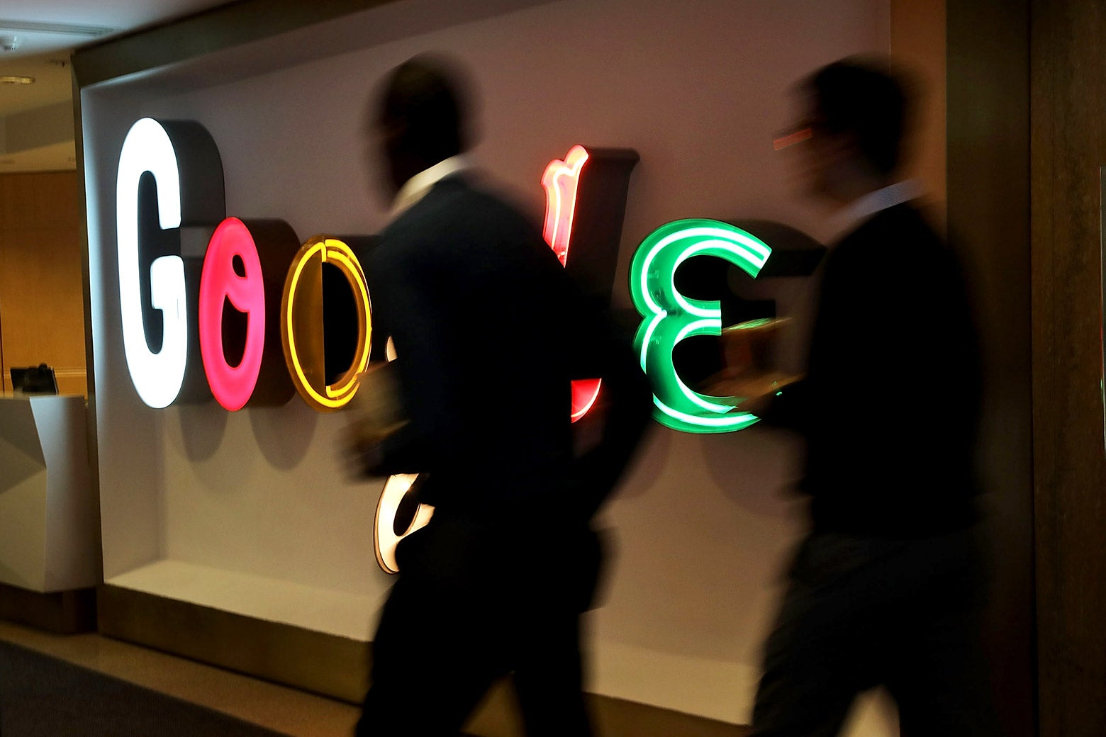 People walk into Google's New York offices on March 5, 2018 in New York City.