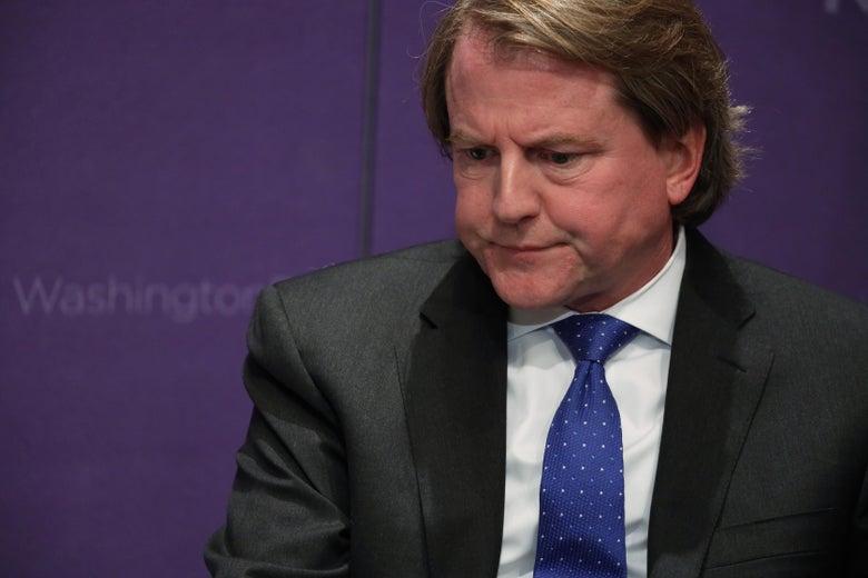 Don McGahn sits against a purple backdrop.