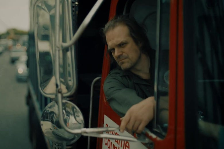 David Harbour sticks his head out of a garbage truck like Joaquin Phoenix in Joker.