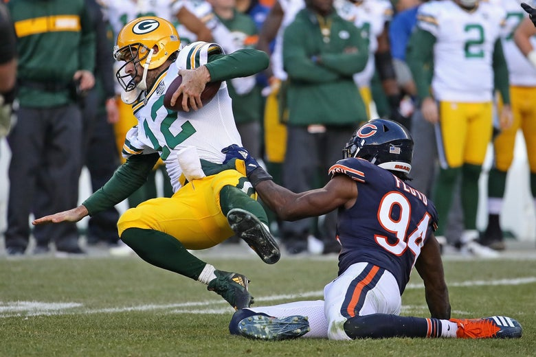 CHICAGO, IL - DECEMBER 16:  Aaron Rodgers #12 of the Green Bay Packers is sacked by Leonard Floyd #94 of the Chicago Bears at Soldier Field on December 16, 2018 in Chicago, Illinois.The Bears defeated the Packers 24-17.  (Photo by Jonathan Daniel/Getty Images)