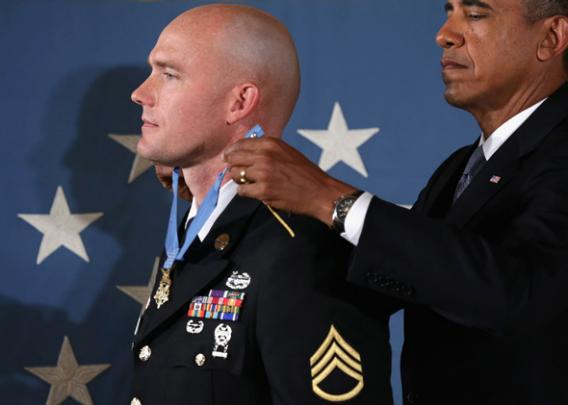President Obama (R) awards U.S. Army Staff Sergeant Ty M. Carter the Medal of Honor for conspicuous gallantry.