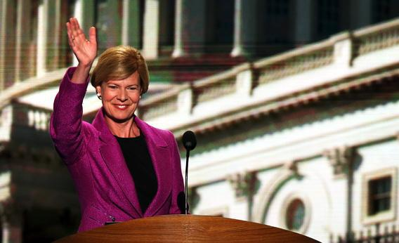 U.S. Rep. Tammy Baldwin (D-WI) waves on stage during the final day of the Democratic National Convention.