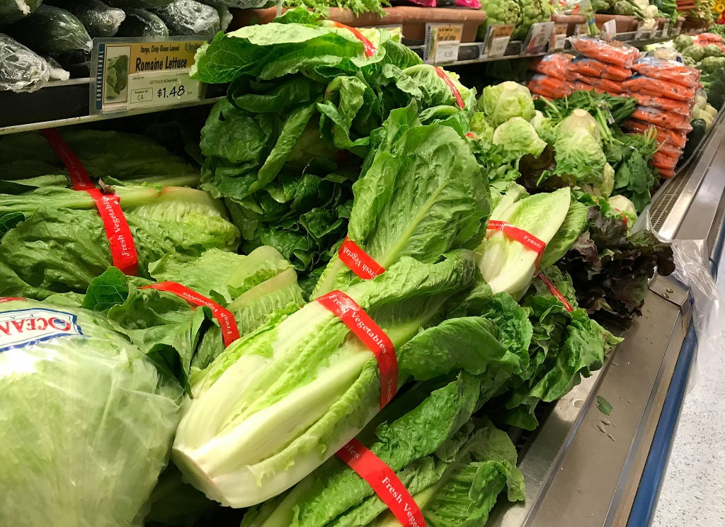 Piles of lettuce in a supermarket.