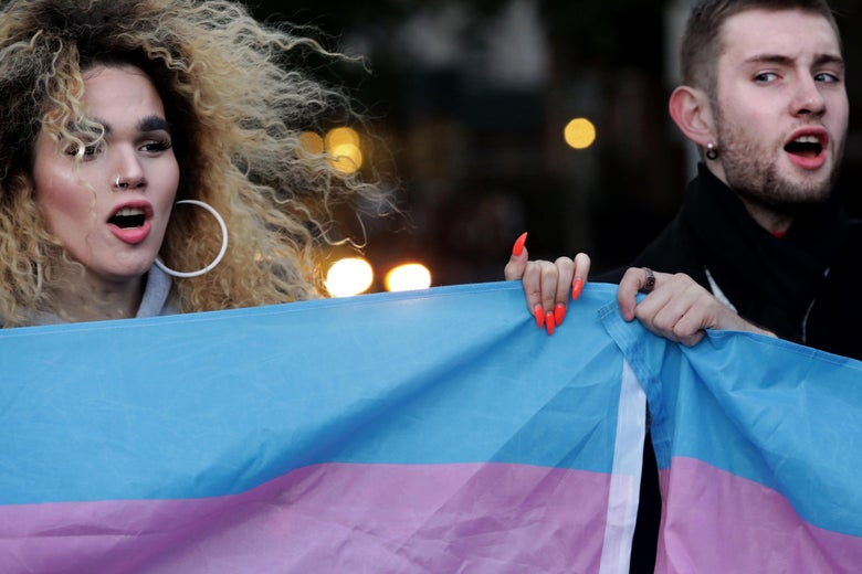 Protestors hold up the flag for Transgender and Gender Noncomforming people at a rally for LGBTQ rights at Washington Square Park on October 21, 2018 in New York City.