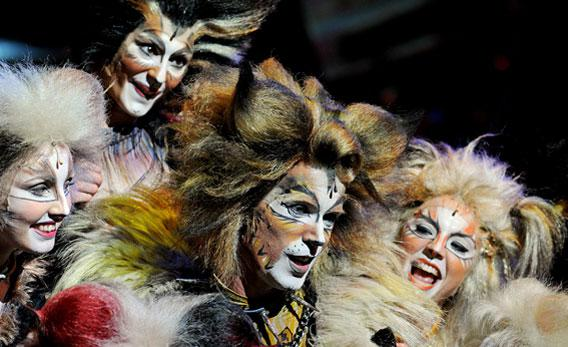 Cast member 'Rum Tum Tugger' (C) performs with others during a media call for the musical 'Cats'.