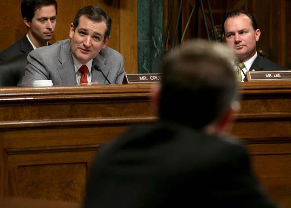 Senate Judiciary Committee members Sen. Ted Cruz (R-TX) (2nd L) and Sen. Mike Lee (R-UT) (R) question David Barron during his nomination hearing November 20, 2013 in Washington, DC.