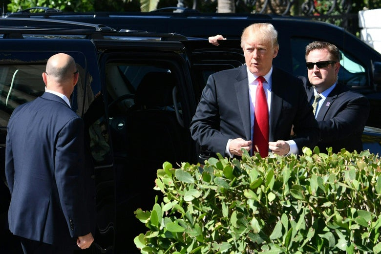 President Trump emerges from a black SUV.