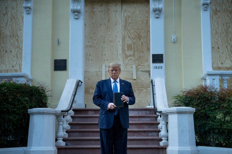 Trump holds a Bible in front of a boarded-up church
