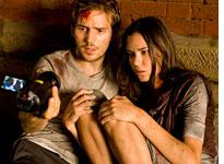 Michael Stahl-David (left) and Odette Yustman are terrorized by a monstrous creature in Cloverfield         Click image to expand.