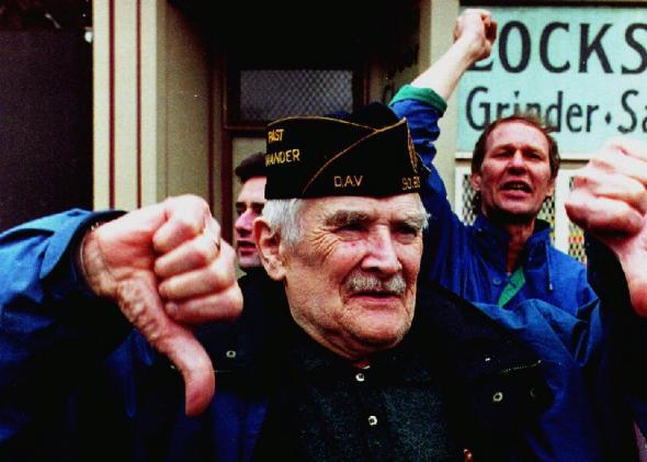 Spectators react to the Irish American Gay, Lesbian, and Bisexual Group of Boston during their appearance in the 1993 South Boston St. Patrick's Day Parade.