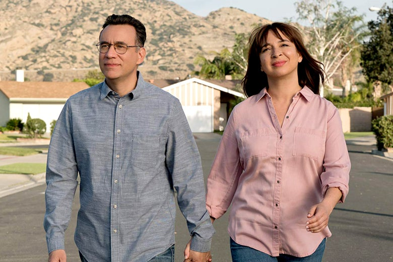 Fred Armisen and Maya Rudolph stroll down a street a still from Forever.