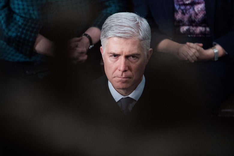 Neil Gorsuch in his robe.