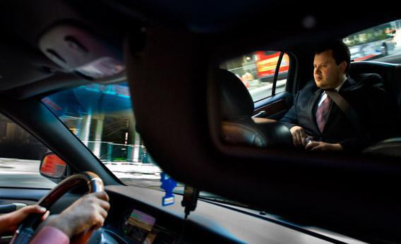 Brendan Kownacki rides in the UBER Car that he beckon via a smartphone app in Washington, DC on July 16, 2012.