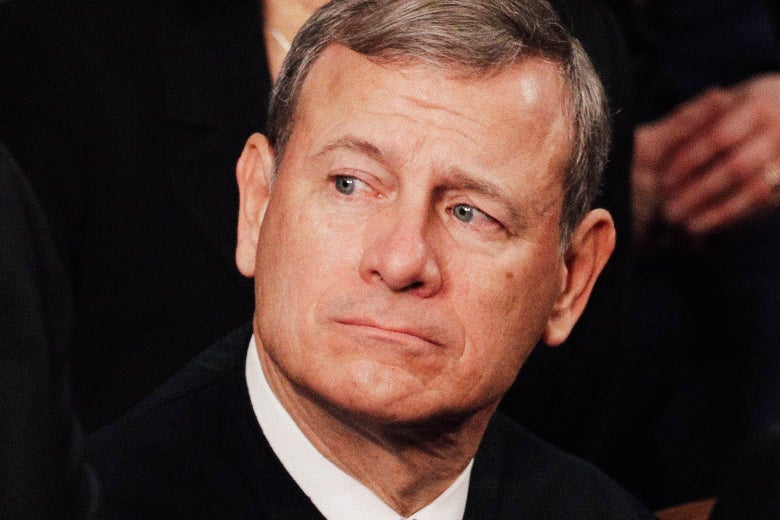 Chief Justice John Roberts looks on during the State of the Union address in the chamber of the House of Representative