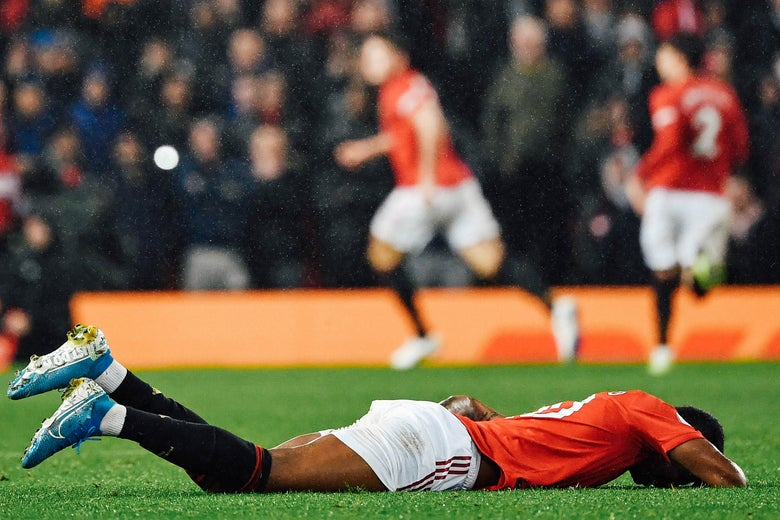 Marcus Rashford lies on the ground.
