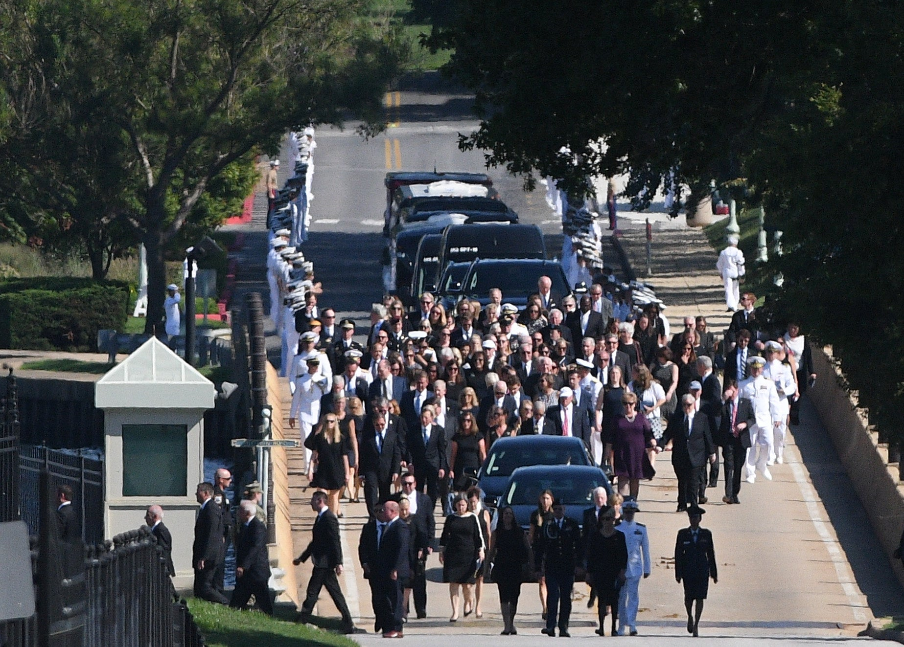 A hearse containing the body of the late Senator John McCain arrives for a private memorial service and burial at the U.S. Naval Academy in Annapolis on September 2, 2018.