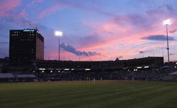 Riverfront Stadium at sunset.