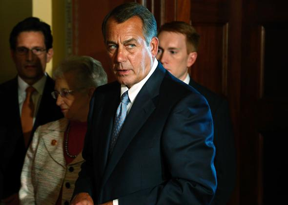 House Speaker John Boehner (R-OH) (C) takes the lectern to speak at a news conference with fellow House Republican leaders.