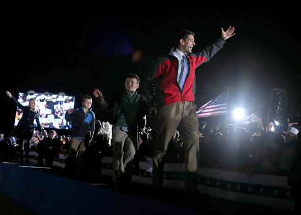 Rep. Paul Ryan (R-WI) waves to supporters during a campaign rally at Hoover High School on October 26, 2012 in Akron, Ohio.