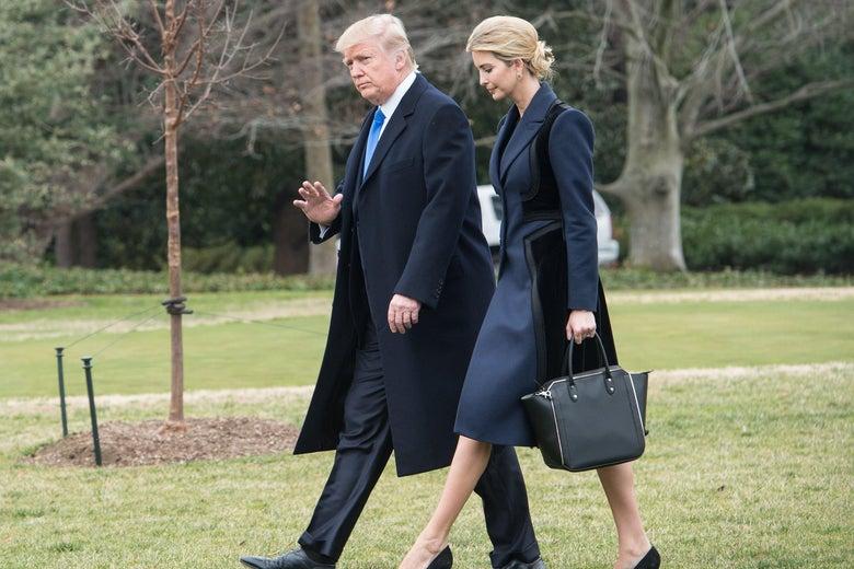 Donald and Ivanka Trump walk towards Marine One to board it.