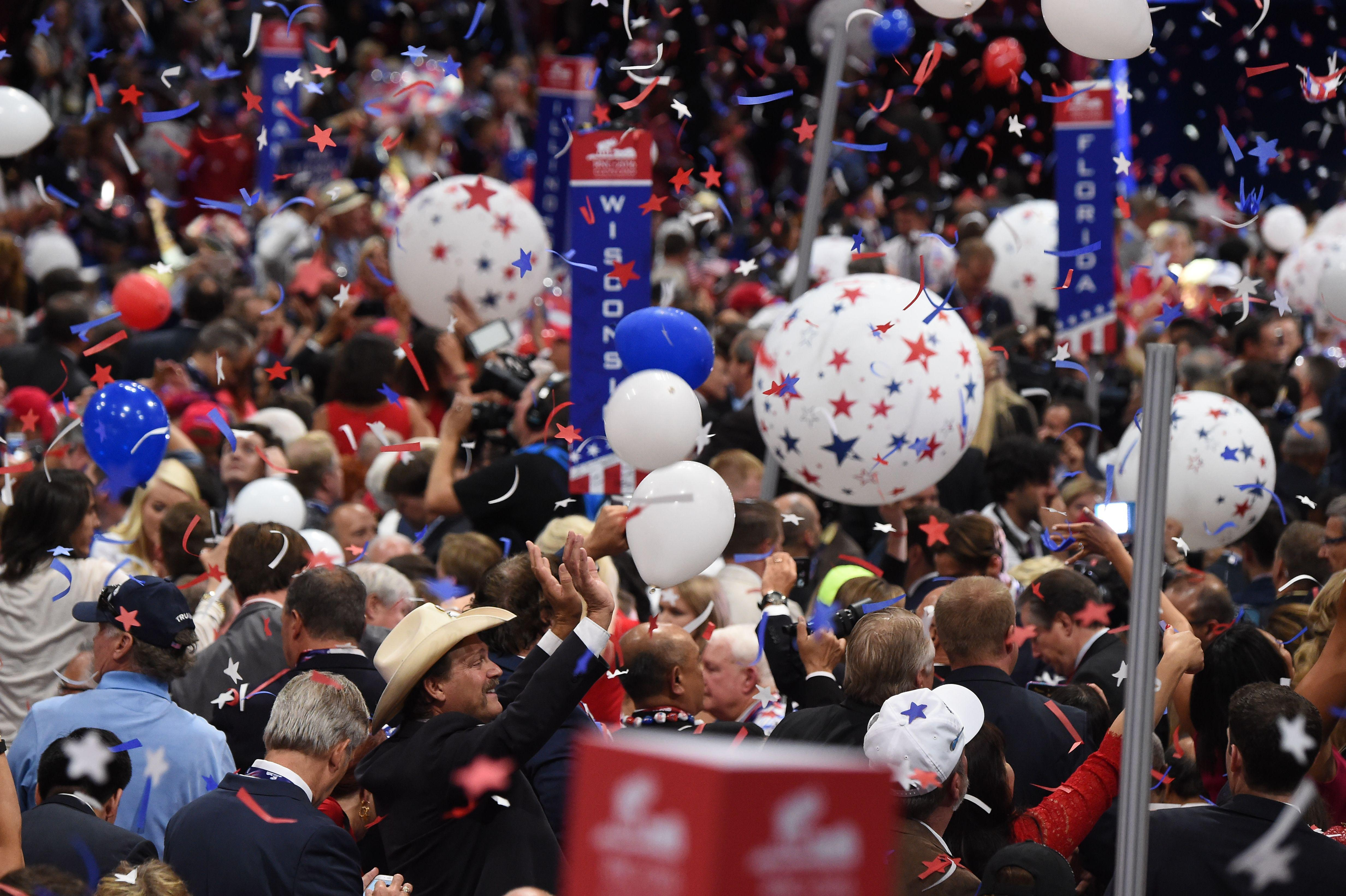 Balloons and confetti descend following an address by Donald Trump.