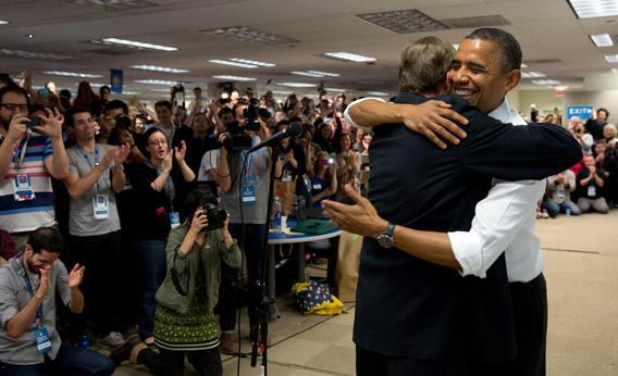 Pres. Obama bear hugs his campaign manager Jim Messina at campaign headquarters in Chicago.