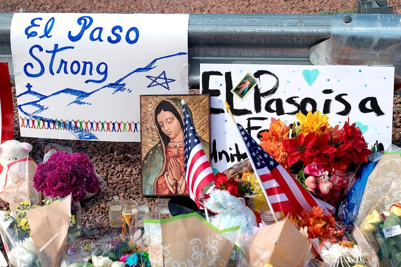 Flowers and signs are seen at a makeshift memorial on Monday after the shooting that left 21 people dead at the Cielo Vista Mall WalMart in El Paso, Texas.