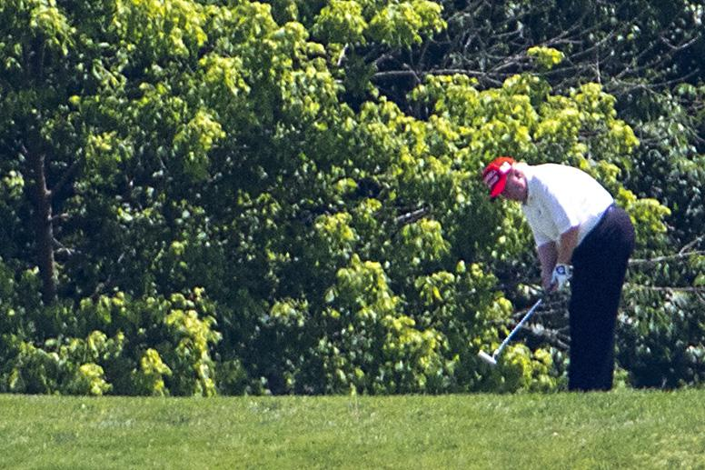Trump golfs at Trump National Golf Club in Potomac Falls, Virginia.