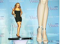 Mariah Carey, with legs. Click image to expand.