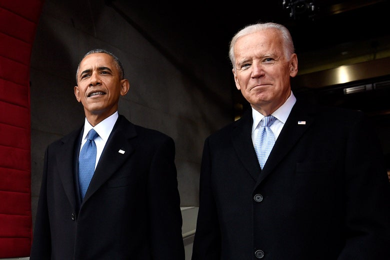 Barack Obama and Joe Biden stand side by side.
