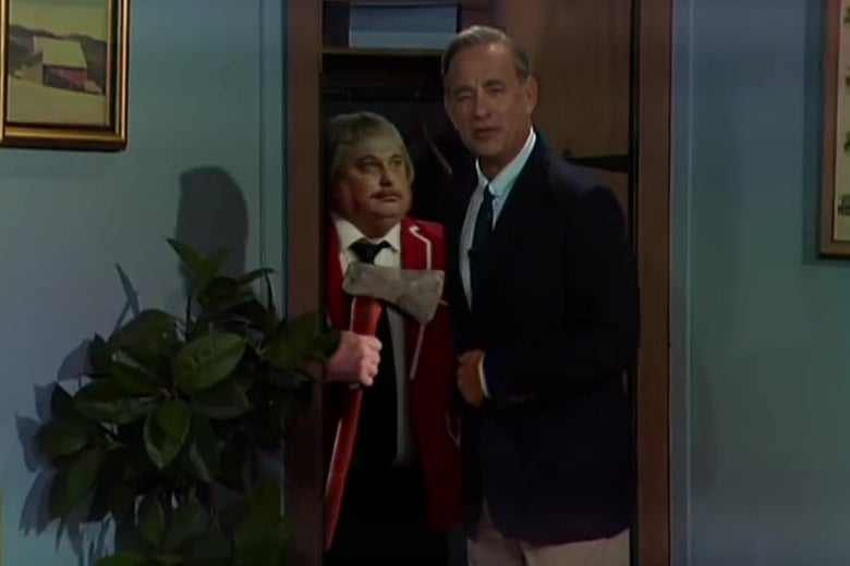Tom Hanks, dressed as Mister Rogers, opens his closet door to find Captain Kangaroo hiding with an ax.