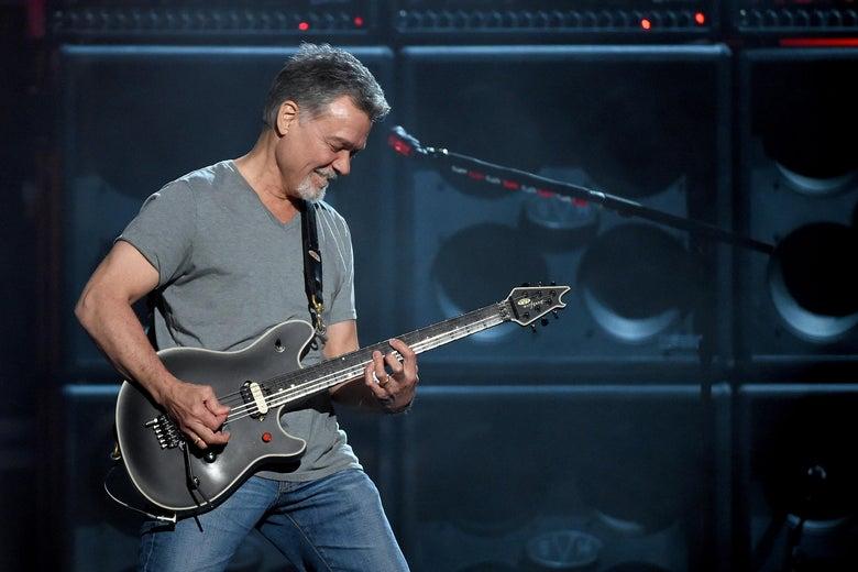 Guitarist Eddie Van Halen playing a black guitar onstage in Las Vegas.