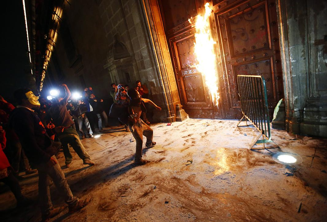 A group of protesters set fire to presidential palace's wooden door on Nov. 8.
