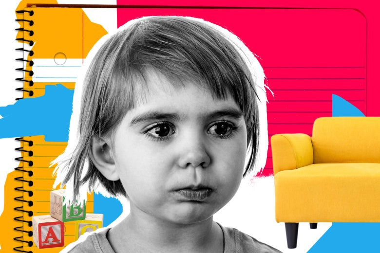 A little kid crying in front of a couch