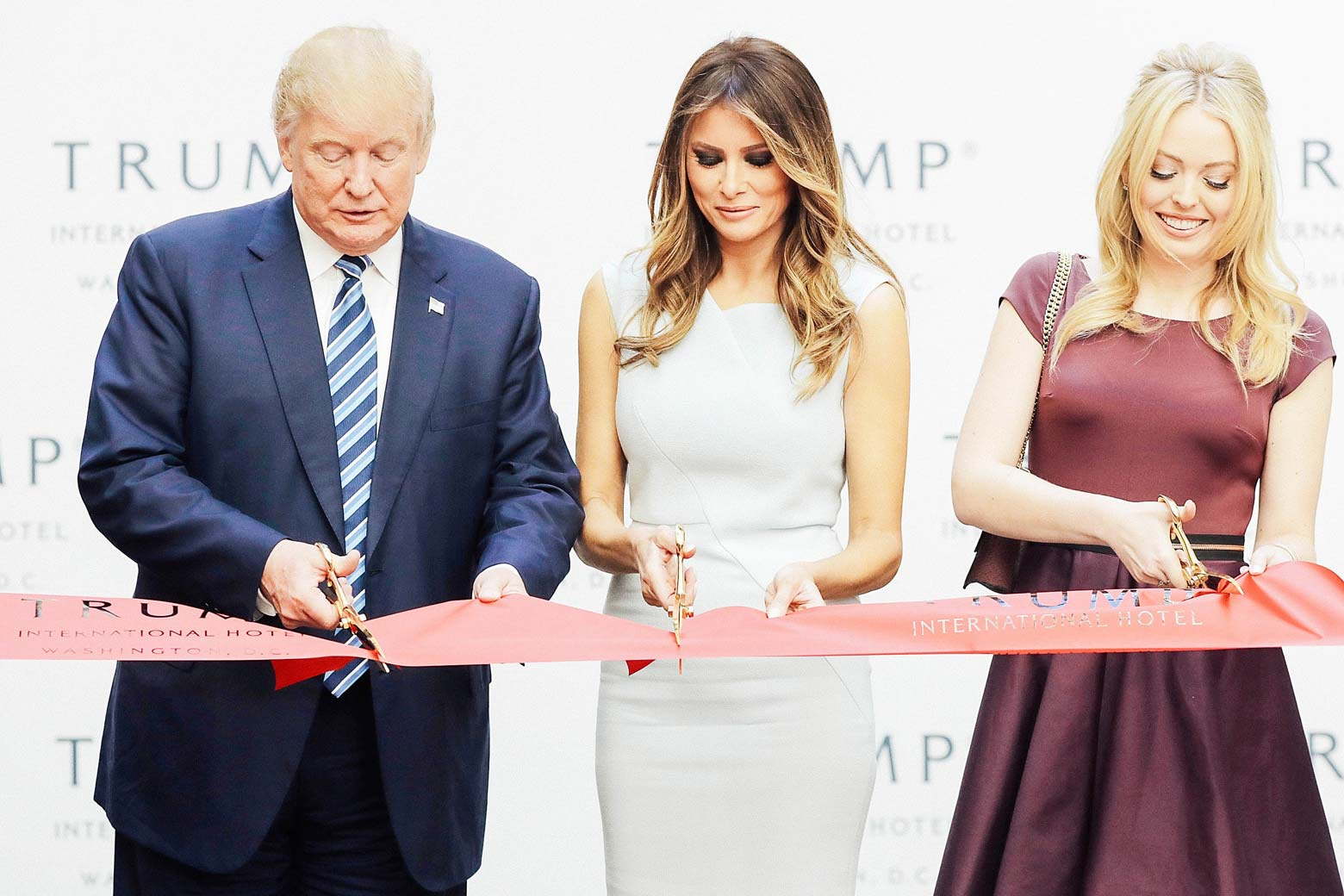Donald, Melania, and Tiffany Trump cut the ribbon at the Trump International Hotel.